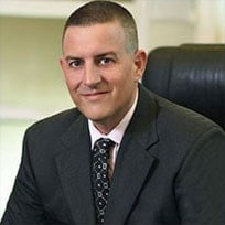 Attorney Gregory H. Comings